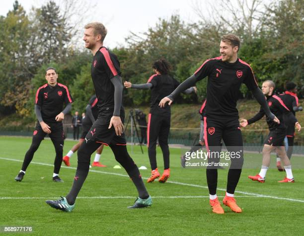 Per Mertesacker and Aaron Ramsey of Arsenal during a training session at London Colney on November 1 2017 in St Albans England