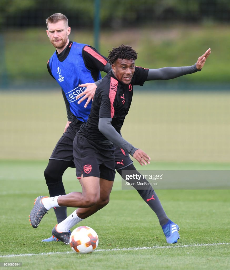 Per Mertesacker and Alex Iwobi of Arsenal during a training session at London Colney on April 25, 2018 in St Albans, England.