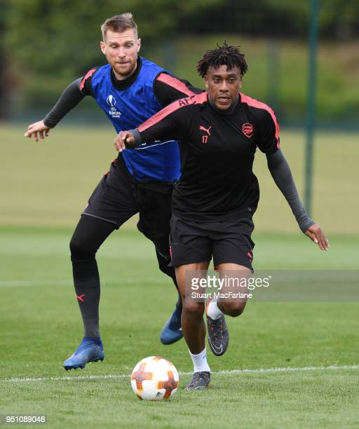 Per Mertesacker and Alex Iwobi of Arsenal during a training session at London Colney on April 25 2018 in St Albans England
