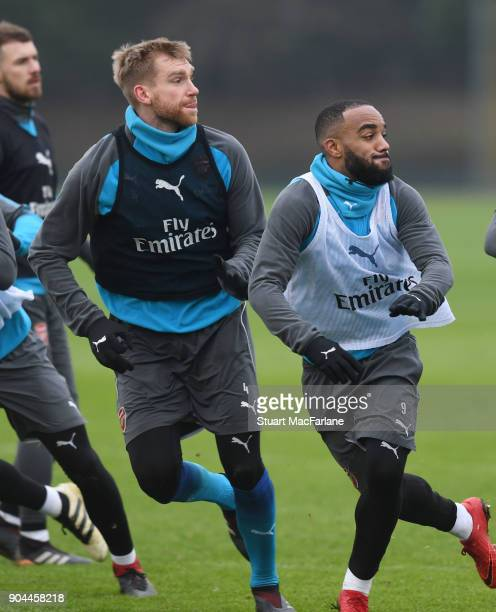 Per Mertesacker and Alex Lacazette of Arsenal during a training session at London Colney on January 13 2018 in St Albans England