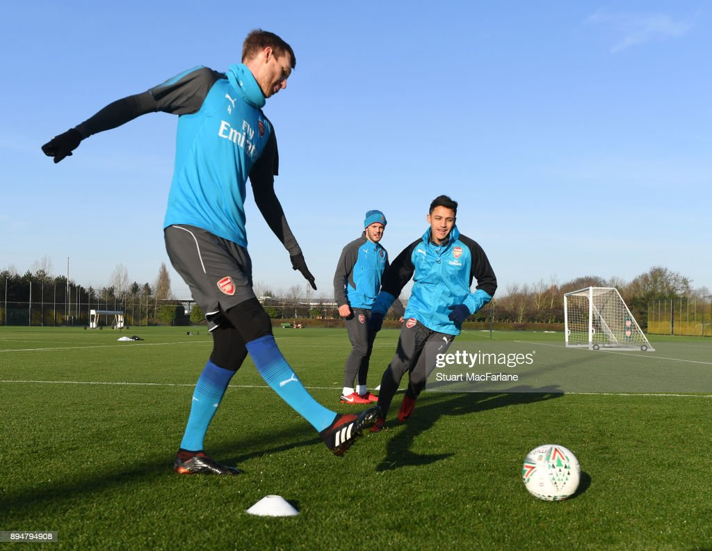 Per Mertesacker and Alexis Sanchez of Arsenal during a training session at London Colney on December 18, 2017 in St Albans, England.