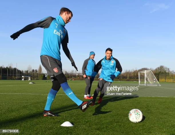 Per Mertesacker and Alexis Sanchez of Arsenal during a training session at London Colney on December 18 2017 in St Albans England