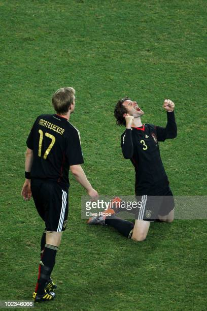 Per Mertesacker and Arne Friedrich of Germany celebrate victory after the 2010 FIFA World Cup South Africa Group D match between Ghana and Germany at...