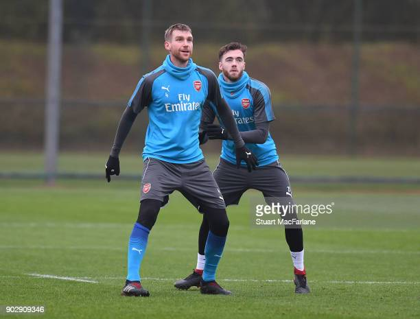 Per Mertesacker and Calum Chambers of Arsenal during a training session at London Colney on January 9 2018 in St Albans England