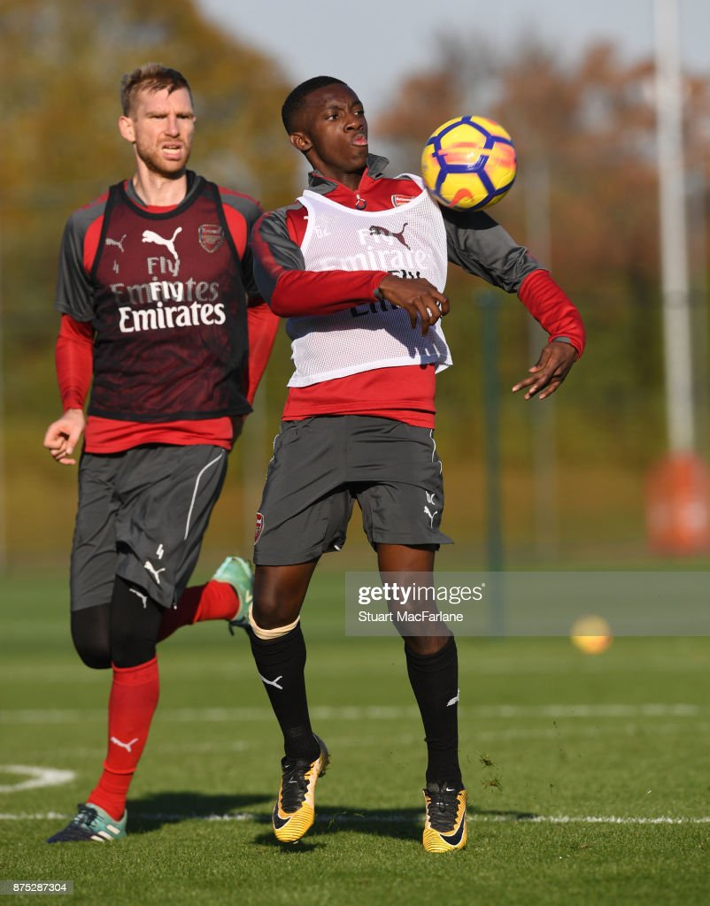 Per Mertesacker and Eddie Nketiah of Arsenal during a training session at London Colney on November 17, 2017 in St Albans, England.
