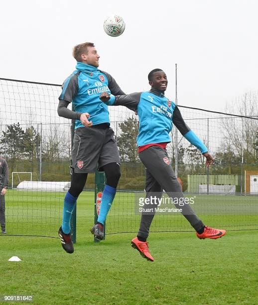 Per Mertesacker and Eddie Nketiah of Arsenal during a training session at London Colney on January 23 2018 in St Albans England