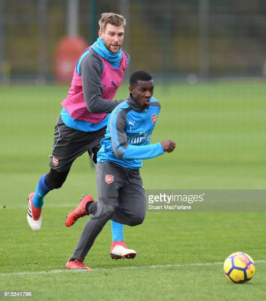 Per Mertesacker and Eddie Nketiah of Arsenal during a training session at London Colney on February 2 2018 in St Albans England