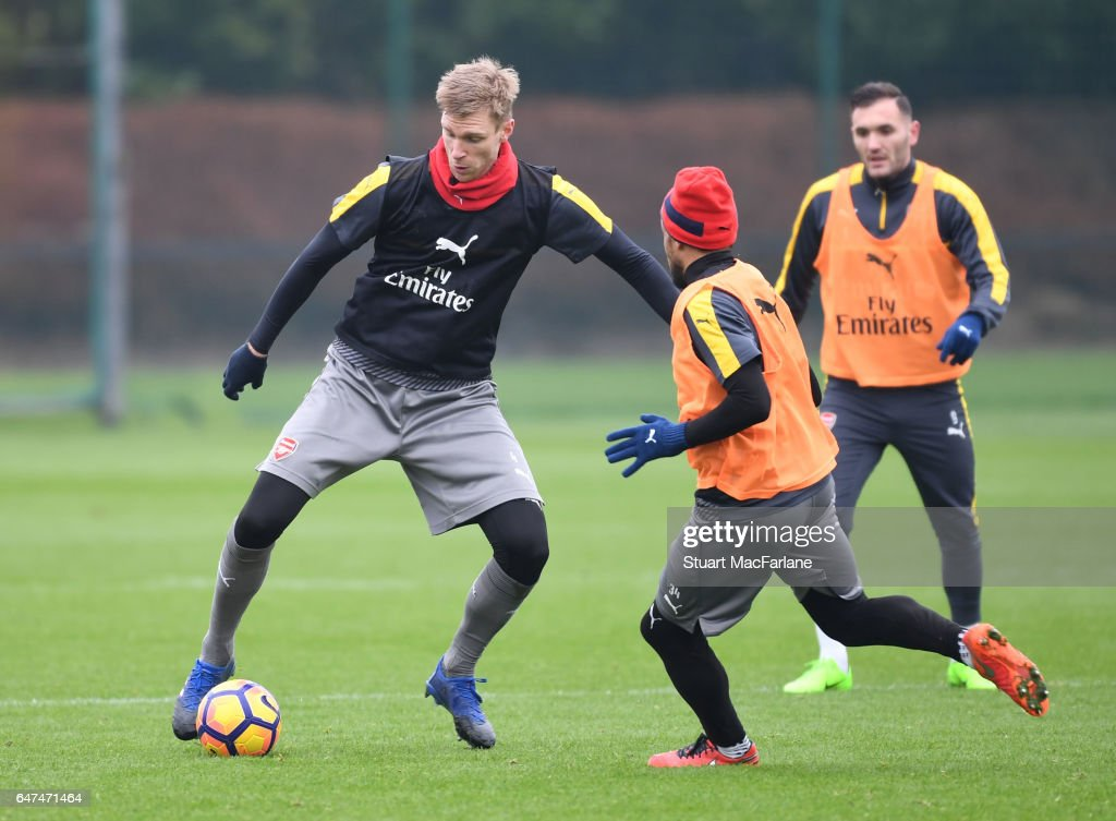 Per Mertesacker and Francis Coquelin of Arsenal during a training session at London Colney on March 3, 2017 in St Albans, England.