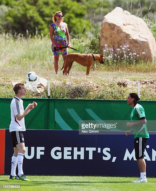 Per Mertesacker and goalkeeper Tim Wiese exercise during a Germany training session at Campo Sportivo Comunale Andrea Dora on May 13, 2012 in Olbia,...
