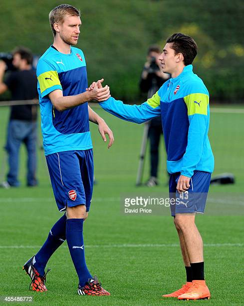 Per Mertesacker and Hector Bellerin of Arsenal during the Arsenal Training Session at London Colney on September 15 2014 in St Albans England