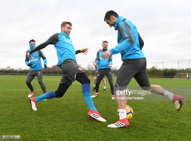 Per Mertesacker and Henrikh Mkhitaryan of Arsenal during a training session at London Colney on January 29 2018 in St Albans England
