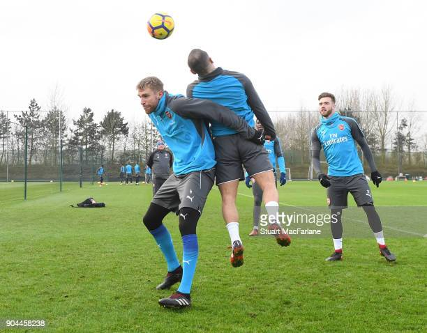 Per Mertesacker and Jack Wilshere of Arsenal during a training session at London Colney on January 13 2018 in St Albans England