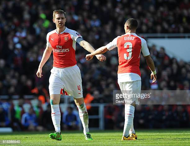 Per Mertesacker and Kieran Gibbs of Arsenal during the match between Arsenal and Watford in the FA Cup 6th round at Emirates Stadium on March 13 2016...