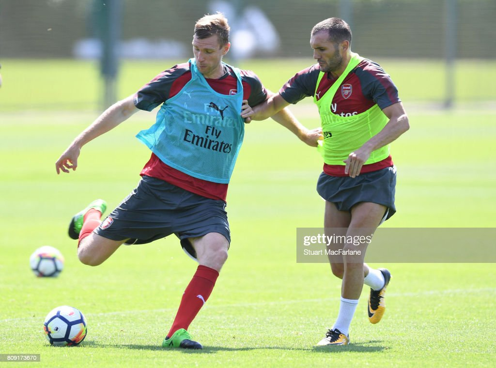 Per Mertesacker and Lucas Perez of Arsenal during a training session at London Colney on July 5, 2017 in St Albans, England.
