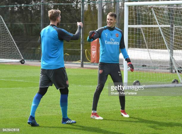 Per Mertesacker and Matt Macey of Arsenal during a training session at London Colney on April 7 2018 in St Albans England