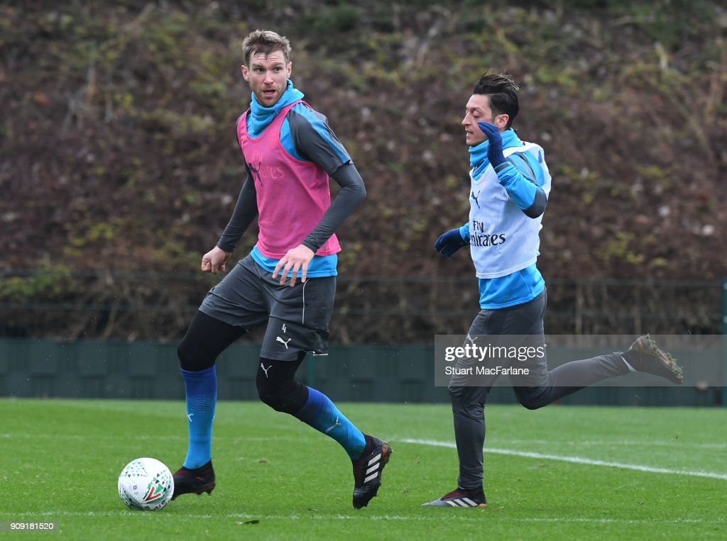 Per Mertesacker and Mesut Ozil of Arsenal during a training session at London Colney on January 23, 2018 in St Albans, England.