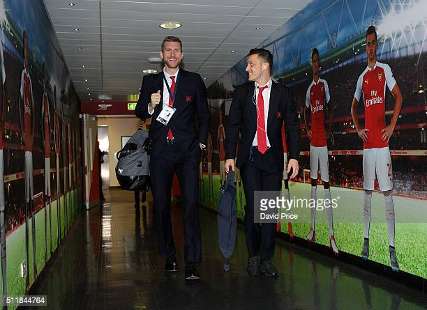 Per Mertesacker and Mesut Ozil of Arsenal walks to the changing room before match between Arsenal and Barcelona the UEFA Champions League Round of 16...