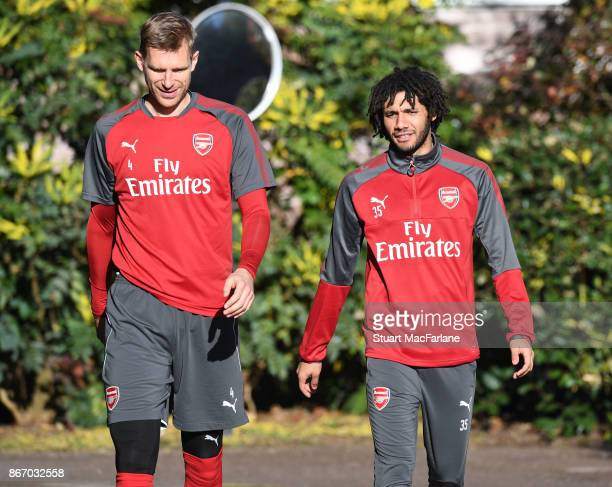 Per Mertesacker and Mohamed Elneny of Arsenal before a training session at London Colney on October 27 2017 in St Albans England
