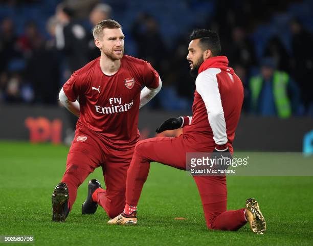 Per Mertesacker and Theo Walcott of Arsenal before the Carabao Cup SemiFinal First Leg match between Chelsea and Arsenal at Stamford Bridge on...