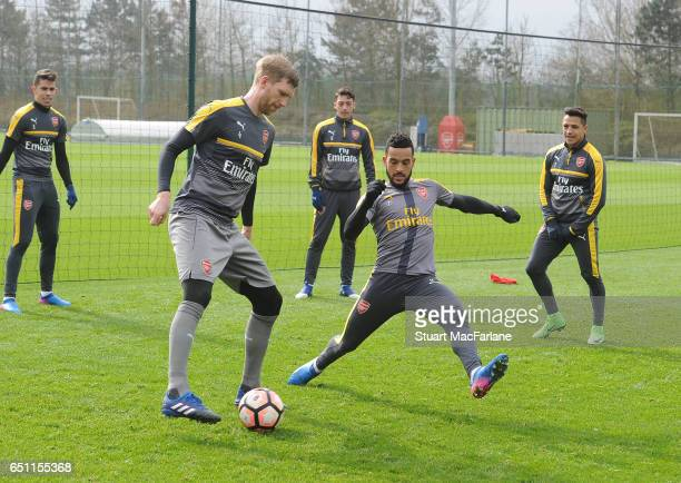 Per Mertesacker and Theo Walcott of Arsenal during a training session at London Colney on March 10 2017 in St Albans England