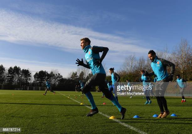 Per Mertesacker and Theo Walcott of Arsenal during a training session at London Colney on December 9 2017 in St Albans England