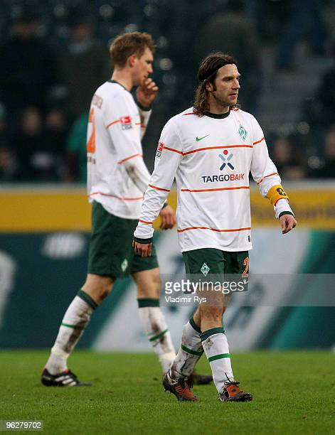 Per Mertesacker and Torsten Frings of Bremen look dejected after losing the Bundesliga match between Borussia Moenchengladbach and SV Werder Bremen...