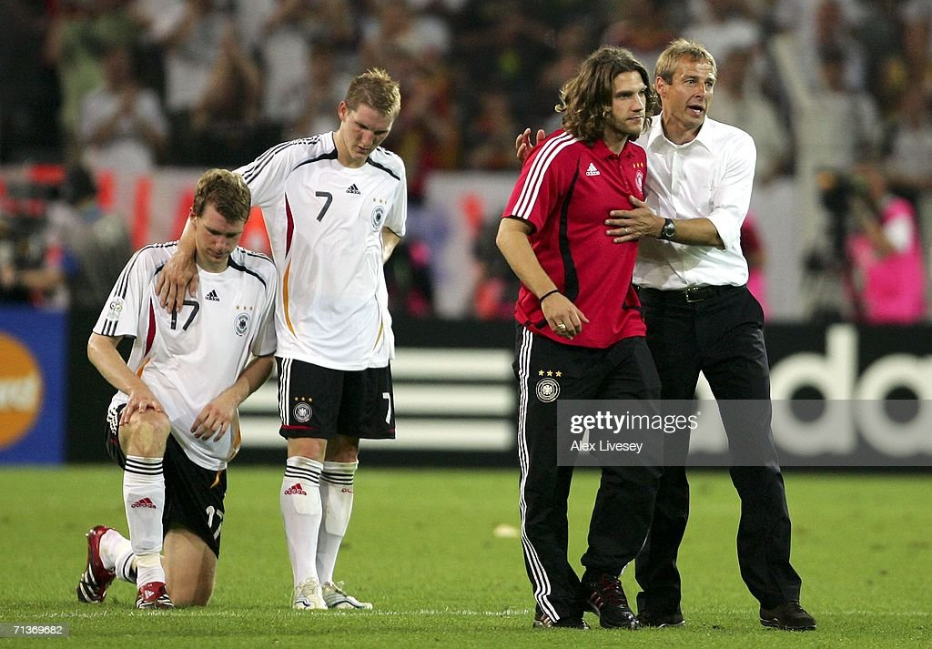 Per Mertesacker, Bastian Schweinsteiger, Torsten Frings of Germany and coach Jurgen Klinsmann look dejected following defeat during the FIFA World Cup Germany 2006 Semi-final match between Germany and Italy played at the Stadium Dortmund on July 04, 2006 in Dortmund, Germany.