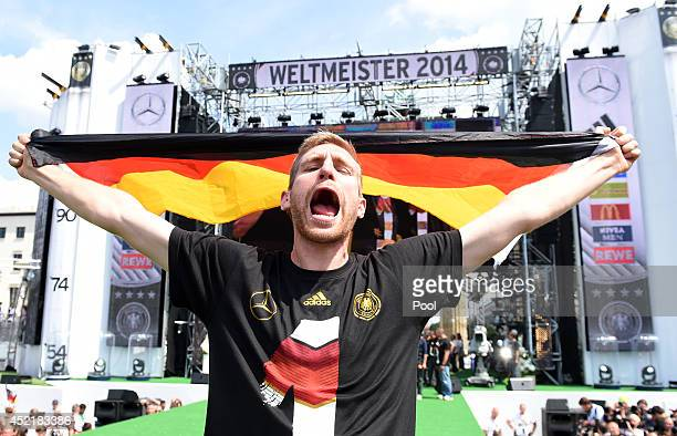 Per Mertesacker celebrates during the German team victory ceremony on July 15, 2014 in Berlin, Germany. Germany won the 2014 FIFA World Cup Brazil...