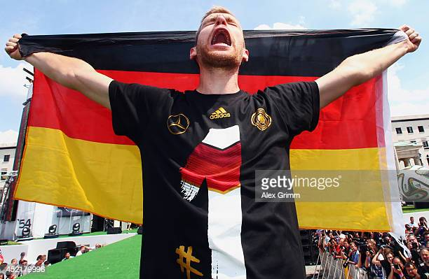 Per Mertesacker celebrates on stage at the German team victory ceremony on July 15 2014 in Berlin Germany Germany won the 2014 FIFA World Cup Brazil...