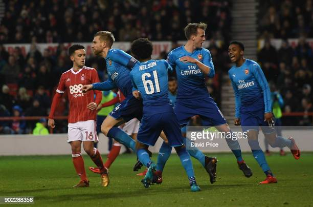 Per Mertesacker celebrates scoring Arsenal's 1st goal during the Emirates FA Cup 3rd Round match between Nottingham Forest and Arsenal at City Ground...
