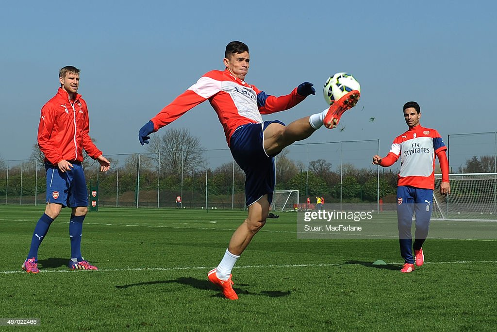 Per Mertesacker, Gabriel and Mikel Arteta of Arsenal during a training session at London Colney on March 20, 2015 in St Albans, England.