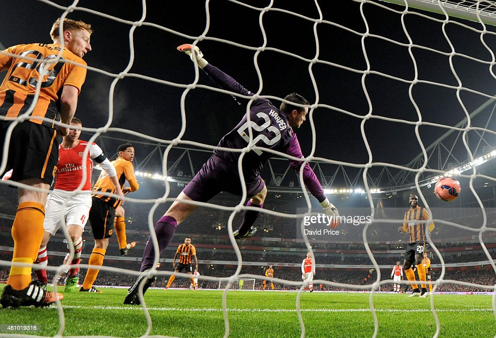 Per Mertesacker heads a goal for Arsenal past Steve Harper of Hull during the match between Arsenal and Hull City in the FA Cup 3rd Round at Emirates Stadium on January 4, 2015 in London, England.