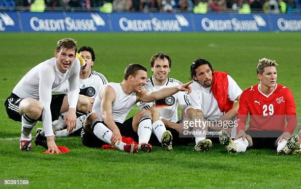 Per Mertesacker Lukas Podolski Heiko Westermann Kevin Kuranyi and Bastian Schweinsteiger of Germany celebrate the winning 40 the international...