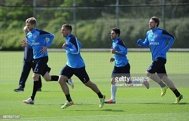 ALBANS ENGLAND MAY 3 Per Mertesacker Lukas Podolski Mikel Arteta and Nicklas Bendtner of Arsenal during a training session at London Colney on May 3...