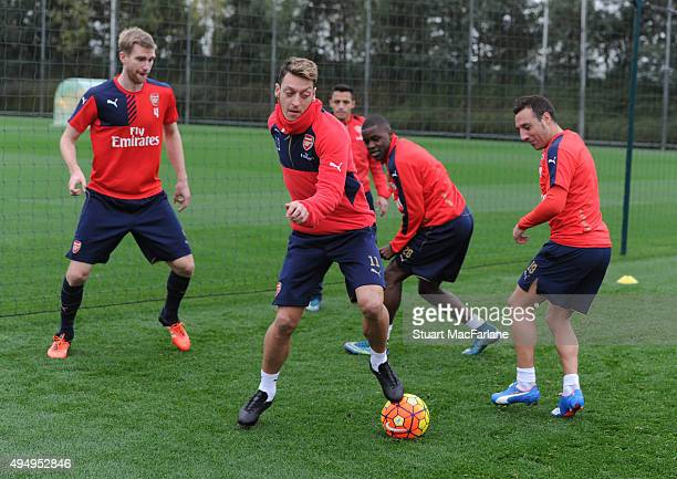 Per Mertesacker Mesut Ozil Joel Campell and Santi Cazorla of Arsenal during a training session at London Colney on October 30 2015 in St Albans...