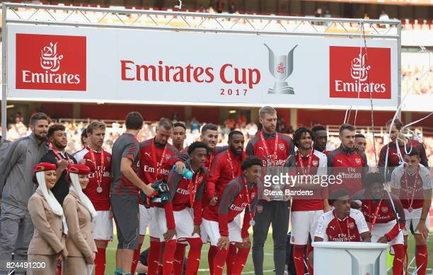 Per Mertesacker of Arsenal and his team mates pose with the Emirates Cup after the Emirates Cup match between Arsenal and Sevilla FC at Emirates...
