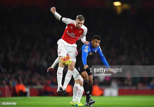 Per Mertesacker of Arsenal and Joshua King of Bournemouth compete for the ball during the Barclays Premier League match between Arsenal and A.F.C....