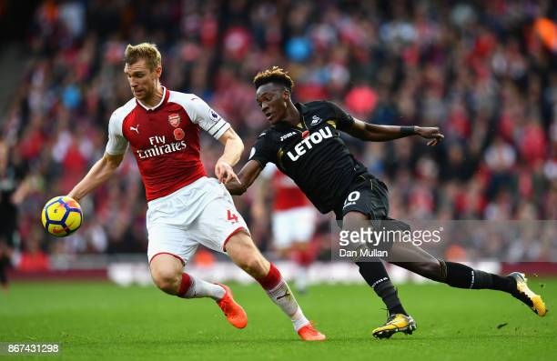 Per Mertesacker of Arsenal and Tammy Abraham of Swansea City battle for possession during the Premier League match between Arsenal and Swansea City...