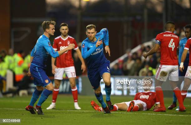 Per Mertesacker of Arsenal celebrates after scoring his goal during the Emirates FA Cup Third Round match between Nottingham Forest and Arsenal at...