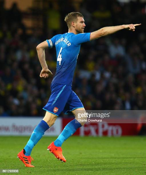 Per Mertesacker of Arsenal celebrates after scoring his sides first goal during the Premier League match between Watford and Arsenal at Vicarage Road...