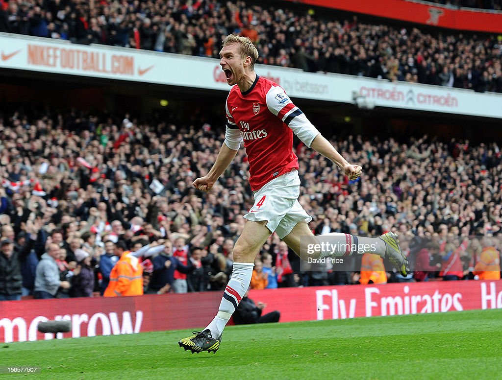 Per Mertesacker of Arsenal celebrates after scoring his team's first goal to equalise during the Barclays Premier League match between Arsenal and Tottenham Hotspur, at Emirates Stadium on November 17, 2012 in London, England.