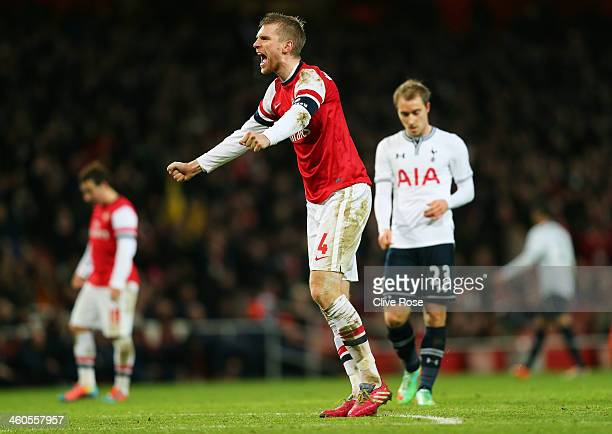 Per Mertesacker of Arsenal celebrates his team's 2-0 victory during the Budweiser FA Cup third round match between Arsenal and Tottenham Hotspur at...