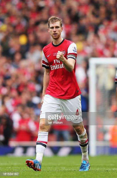 Per Mertesacker of Arsenal celebrates scoring during the Barclays Premier League match between Arsenal and Stoke City at Emirates Stadium on...