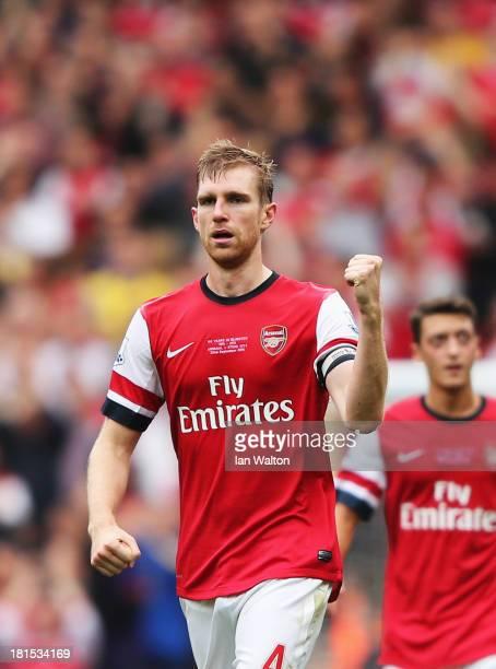 Per Mertesacker of Arsenal celebrates scoring during the Barclays Premier League match between Arsenal and Stoke City at Emirates Stadium on...