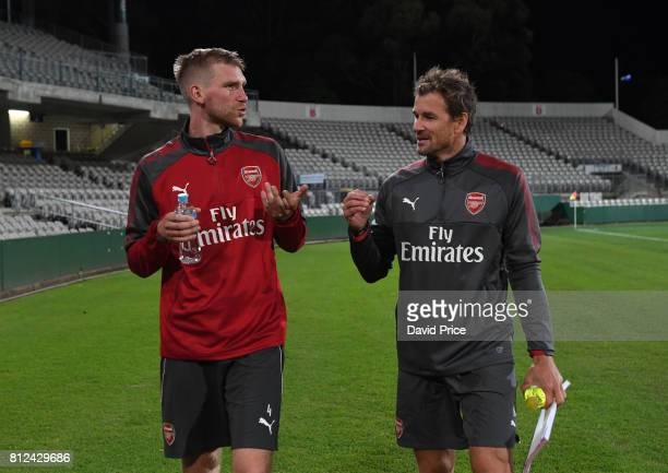 Per Mertesacker of Arsenal chats to Arsenal Coach Jens Lehmann during the Arsenal Training Session at Koragah Oval on July 11 2017 in Sydney Australia