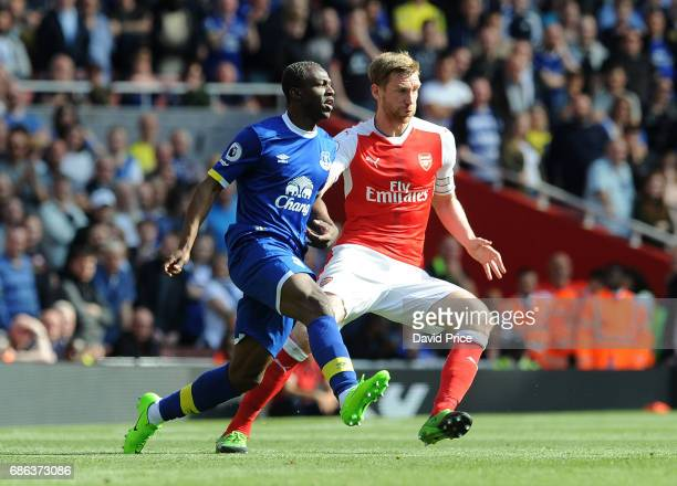 Per Mertesacker of Arsenal closes down Arouna Kone of Everton during the Premier League match between Arsenal and Everton at Emirates Stadium on May...