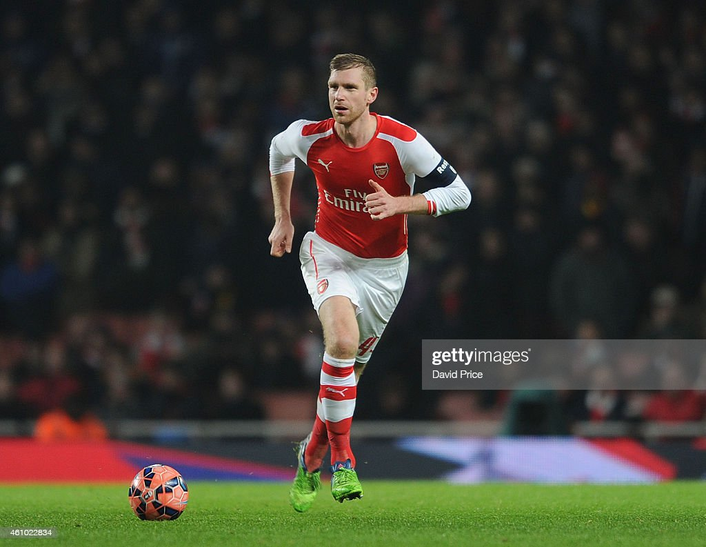 Per Mertesacker of Arsenal during the match between Arsenal and Hull City in the FA Cup 3rd Round at Emirates Stadium on January 4, 2015 in London, England.