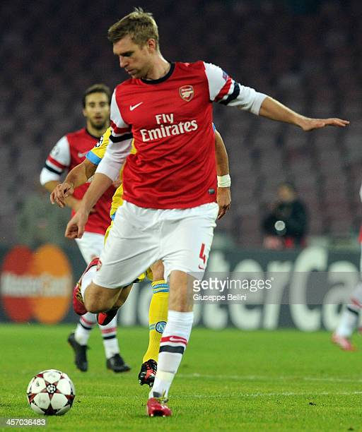 Per Mertesacker of Arsenal in action during the UEFA Champions League Group F match between SSC Napoli and Arsenal at Stadio San Paolo on December 11...