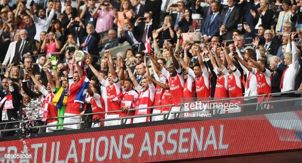 Per Mertesacker of Arsenal lifts The FA Cup after The Emirates FA Cup Final between Arsenal and Chelsea at Wembley Stadium on May 27 2017 in London...