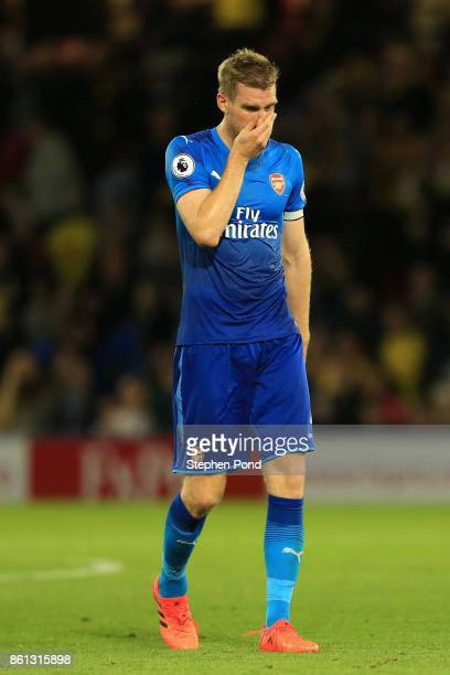 Per Mertesacker of Arsenal looks dejected in defence the Premier League match between Watford and Arsenal at Vicarage Road on October 14, 2017 in...